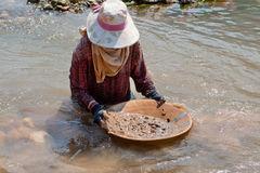woman-washing-gold-river-13623411