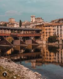 "Bassano del Grappa sits on the Brenta River; Andrea Palladio designed bridge rebuilt by ""Alpini"" after WWI"