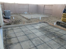 Two pads for patio and shed.